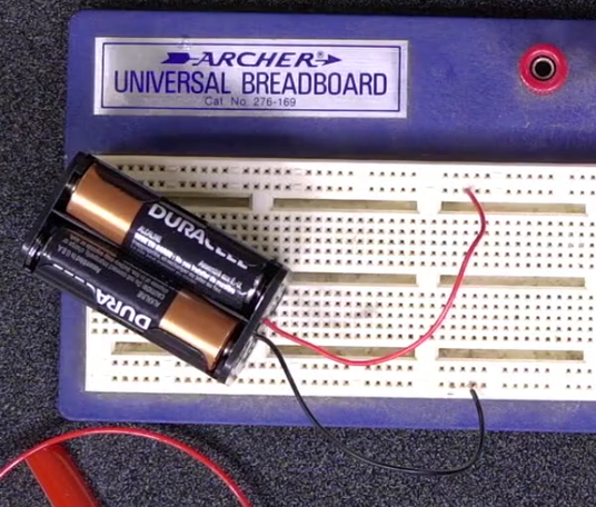 Battery pack leads connected to breadboard positive and negative buses
