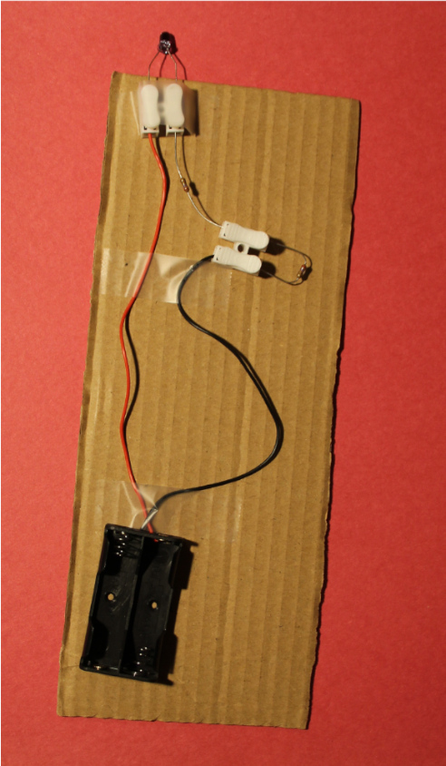 Robot transmitter circuit including battery pack, IR LED, and two 2.7 ohm resistors wired in series.